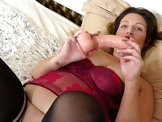 Fat Woman In Dark Crimson, Erotic Underwear Is Playing With Her Hump Fucktoys, In Her Sofa