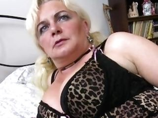 Europemature Blonde Lady Is Playing On The Couch